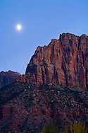Moonrise in evening light over the cliffs of Johnson Mountain, Springdale, nearZion National Park, Utah