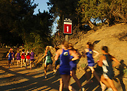 Oct 20, 2006; Walnut, CA, USA; Runners pass the mile marker and prepare to ascend the Switchbacks Hills at the 59th Mt. San Antonio College Cross Country Invitational.