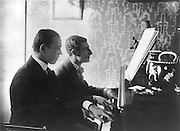 Maurice Ravel, 1875-1937, French composer, pianist and conductor, and Vaslav Nijinsky, 1889-1950, Russian ballet dancer and choreographer, playing the piano, photograph, 1912, by unknown photographer. Copyright © Collection Particuliere Tropmi / Manuel Cohen