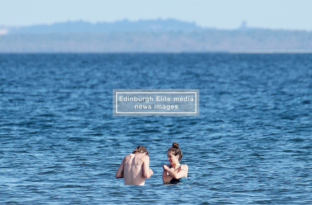 Kayne and Tamsin from the Republic of Ireland in the sea at Portobello Beach in Edinburgh during a sunny first day of Autumn.<br /> <br /> Edinburgh Weather Pictures, Thursday 22nd September 2016<br /> <br /> (c) Alex Todd   Edinburgh Elite media