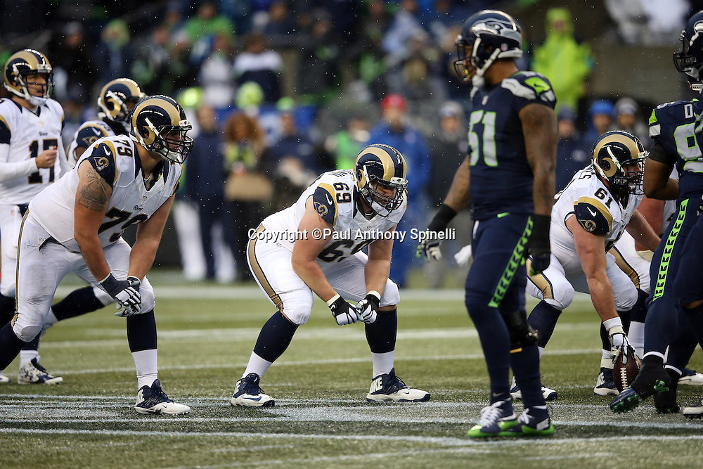 St. Louis Rams offensive guard Cody Wichmann (69) gets set at the line of scrimmage during the 2015 NFL week 16 regular season football game against the Seattle Seahawks on Sunday, Dec. 27, 2015 in Seattle. The Rams won the game 23-17. (©Paul Anthony Spinelli)