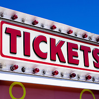 Picture of a tickets sign on a tickets booth at a carnival. Ticket booths are also frequently used at amusement parks, county fairs and festivals. Image is available as a stock photo, poster or print.