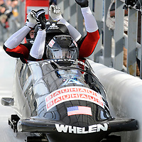 01 March 2009:    The USA 3 bobsled driven by John Napier with sidepushers Jesse Beckom and Jamie Moriarty, and brakeman Cory Butner celebrate their finish after the 4th run at the 4-Man World Championships competition on March 1 at the Olympic Sports Complex in Lake Placid, NY.   The USA 1 bobsled driven by Steven Holcomb with sidepushers Justin Olsen and Steve Mesler, and brakeman Curtis Tomasevicz won the competition and the World Championship bringing the U.S. their first world championship since 1959 with a time of 3:36.61.