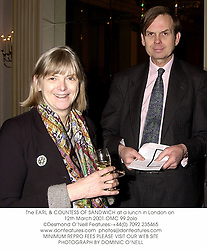The EARL & COUNTESS OF SANDWICH at a lunch in London on 12th March 2001.OMC 99 2olo
