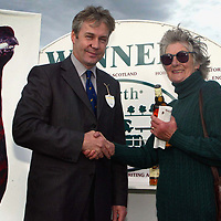 Famous Grouse day at the races..15.05.02<br />Derek Brown, Director of the Famous Grouse Experience makes a presentation to the winning owner of Trivial who won the Famous Grouse Experience Maiden Hurdle race Mrs J Brockbank.<br /><br />For details please contact Emrys Inker at the Edrington Group on 01738 493781<br /><br />Pic by Graeme Hart<br />Copyright Perthshire Picture Agency<br />Tel: 01738 623350 / 07990 594431
