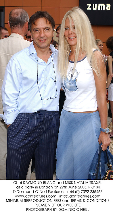 Chef RAYMOND BLANC and MISS NATALIA TRAXEL at a party in London on 29th June 2003.PKY 30