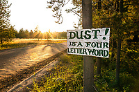 BC00651-00...MONTANA - Sign warning about dust on the road outside Polebridge.