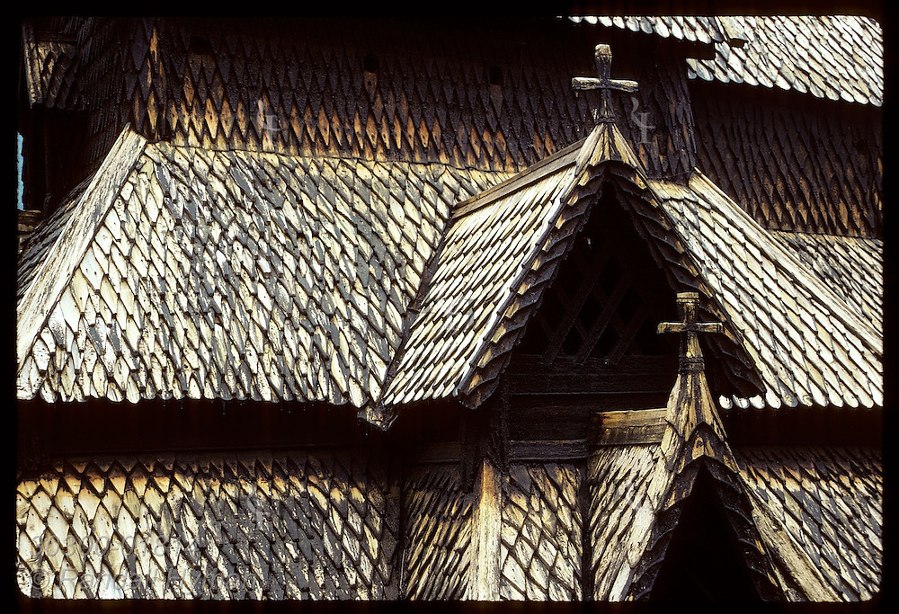 Borgund stave church roof shows how tar, applied each third year by law, quickly wears thin; Sogn Norway