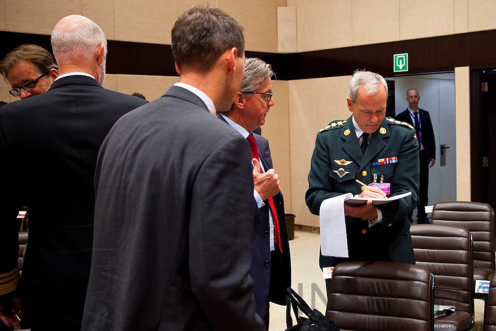 The Danish delegation from clockwise from left is Minister of Defence Nick Haekkerup, Ambassador Carsten Soendergaard and General  Knud Bartels, Chief of Defence, who makes the last preparations before the start of the NATO defence ministers meeting at the alliance headquarters in Brussels October 6, 2011. PHOTO: ERIK LUNTANG / INSPIRIT Photo.