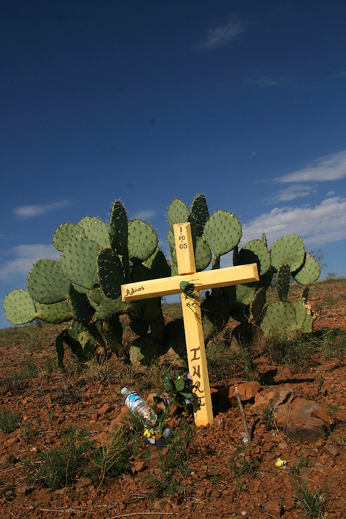 A cross marks the place where the body of an undocumented immigrant was found in the desert near the town of Arvaka, AZ on Saturday July 15, 2006.