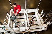 Overhead view of technician repairing motor on electrical circuit