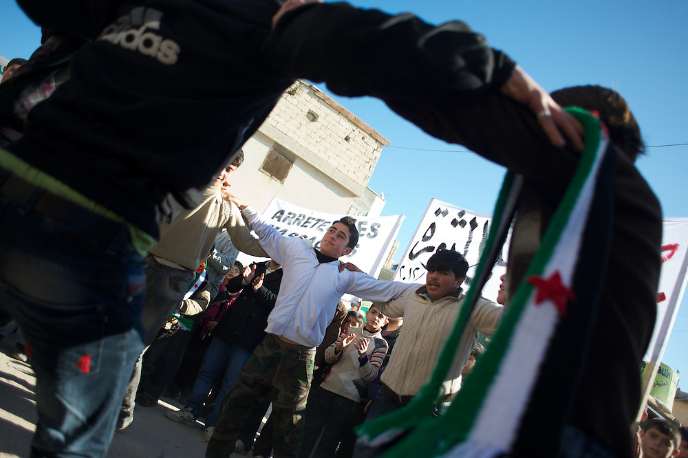 January 20, 2012 - Idleb, Syria: A group of protestors dance during a anti-regime demonstration in central Taftanaz.