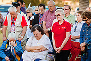 9 MAY 2011 - PHOENIX, AZ: People pray at the start of a political rally in Paradise Valley Park in Phoenix Thursday evening. About 100 people attended the rally, which was to support some of the state's most conservative politicians including Joe Arpaio, Russell Pearce and John Kavanagh. The rally was sponsored by the Maricopa County Republican Party and a Tea Party group.     PHOTO BY JACK KURTZ