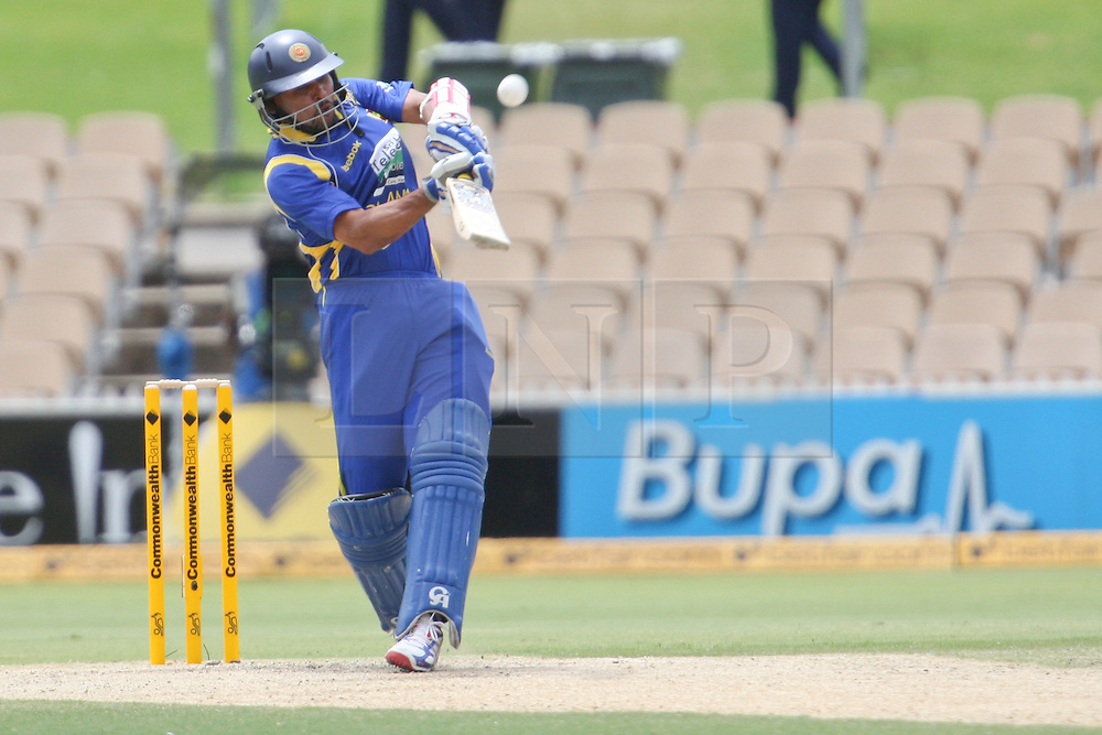 © Licensed to London News Pictures. 14/02/2012. Adelaide Oval, Australia. Sri Lankan batsmen Tillakaratne Dilshan plays a pull shot for 6 during the One Day International cricket match between India Vs Sri Lanka. Photo credit : Asanka Brendon Ratnayake/LNP
