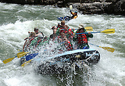 Tourists on commercial rafts make their way through the Lunch Counter rapids on the Snake River in Wyoming.