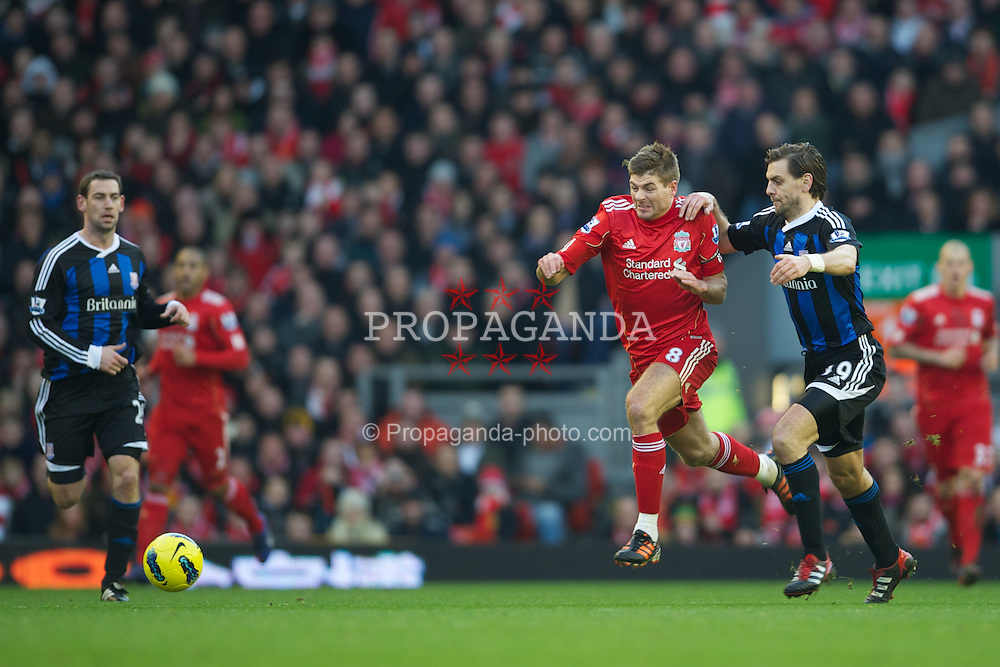 LIVERPOOL, ENGLAND - Saturday, January 14, 2012: Liverpool's captain Steven Gerrard in action against Stoke City's Jonathan Woodgate during the Premiership match at Anfield. (Pic by David Rawcliffe/Propaganda)