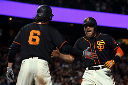 SAN FRANCISCO, CA - AUGUST 05: Hunter Pence #8 of the San Francisco Giants is congratulated by Jarrett Parker #6 after hitting a two run home run against the Arizona Diamondbacks during the seventh inning at AT&T Park on August 5, 2017 in San Francisco, California. The San Francisco Giants defeated the Arizona Diamondbacks 5-4 in 10 innings. (Photo by Jason O. Watson/Getty Images) *** Local Caption *** Hunter Pence; Jarrett Parker