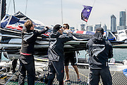 Emirates Team New Zealand prepare for a forecast strong breeze by reefing the main sail before racing on day four of the Land Rover Extreme Sailing Series regatta in Qingdao, China. 4/5/2014