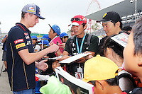 Max Verstappen (NLD) Scuderia Toro Rosso Test Driver signs autographs for the fans.<br /> Japanese Grand Prix, Thursday 2nd October 2014. Suzuka, Japan.