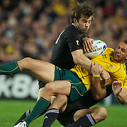 Quade Cooper, Australia, is tackled by Richard Kahui and Conrad Smith, (right), New Zealand) during the New Zealand V Australia Semi Final match at the IRB Rugby World Cup tournament, Eden Park, Auckland, New Zealand, 16th October 2011. Photo Tim Clayton...