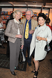 Left to right, LADY HOWELL, JON HALLIDAY and JUNG CHANG at a party to celebrate the publication of Sandra Howard's new book - Ex-Wives held at Daunt Books, 83 Marylebone High Street, London W1 on 30th April 2012.