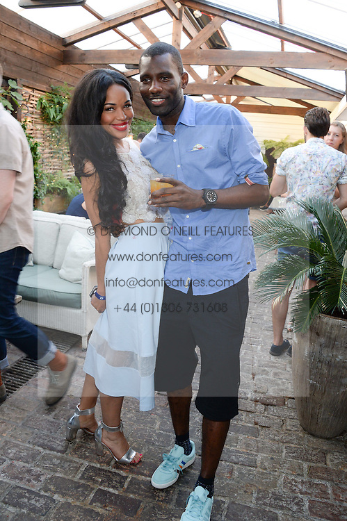 WRETCH 32 and SARAH-JANE CRAWFORD attending the Warner Bros. & Esquire Summer Party held at Shoreditch House, Ebor Street, London E1 on 18th July 2013.