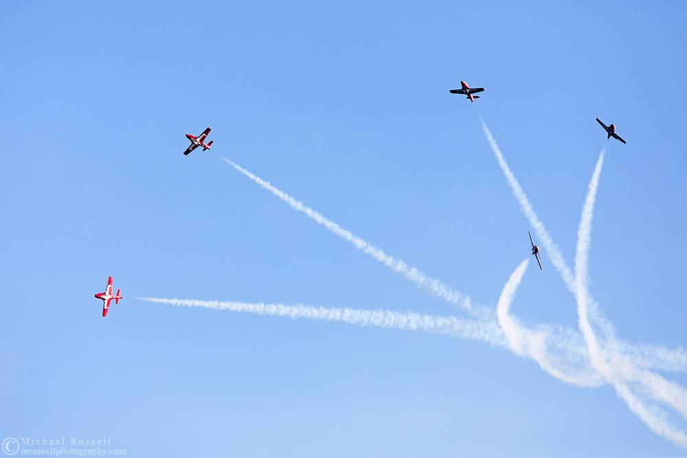 Canadian Forces Snowbirds perform a Lag Back Cross with smoke.  The Snowbirds are also known as the 431 Air Demonstration Squadron and fly the Canadair CT-114 Tutor jet. Photographed during the Canada 150 celebrations in White Rock, British Columbia, Canada.