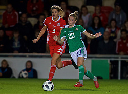 NEWPORT, WALES - Tuesday, September 3, 2019: Wales' Gemma Evans (L) and Northern Ireland's substitute Rebecca McKenna during the UEFA Women Euro 2021 Qualifying Group C match between Wales and Northern Ireland at Rodney Parade. (Pic by David Rawcliffe/Propaganda)