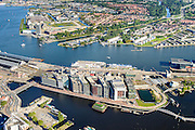 Nederland, Noord-Holland, Amsterdam, 27-09-2015; stadsdeel Centrum. Oosterdokseiland en Amsterdam Centraal Station  gezien naar Buiksloterham in Amsterdam-Noord. IJ met IJ-oevers.<br /> Urban and city development, immediately east of Central Station.<br /> luchtfoto (toeslag op standard tarieven);<br /> aerial photo (additional fee required);<br /> copyright foto/photo Siebe Swart