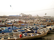 fishermen and their fishing boats, Ghana.