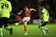 Walsall midfielder, Sam Mantom shoots during the Capital One Cup match between Walsall and Brighton and Hove Albion at the Banks's Stadium, Walsall, England on 25 August 2015.