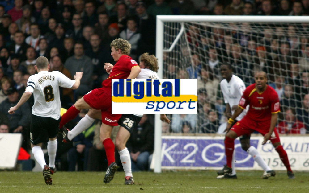 Photo: Chris Ratcliffe.<br />Luton Town v Watford. Coca Cola Championship.<br />02/01/2006.<br />Darius Henderson of Watford squeezes between Kevin Nicholls (L) and Marcus Heikkinen to score the first Watford goal.