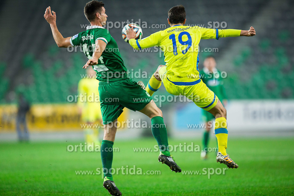 Hrvoje Spahija #44 of Olimpija vs Nemanja Maksimovic #19 of Domzale during football match between NK Olimpija Ljubljana and NK Domzale in 18th Round of Prva liga Telekom Slovenije 2014/15, on November 22, 2014 in SRC Stozice, Ljubljana, Slovenia. Photo by Vid Ponikvar / Sportida