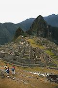 Travelers look out at  Machu Picchu  Peru