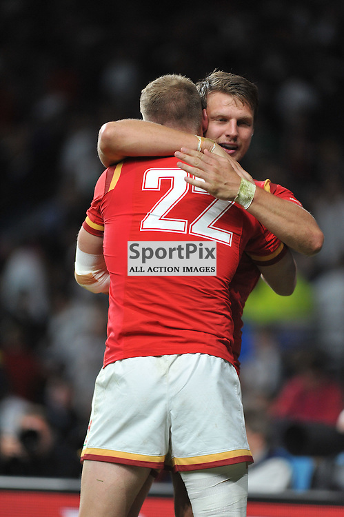 Dan Biggar of Wales and Rhys Priestland of Wales celebrate at the end of the IRB RWC 2015 Pool A match between England and Wales at Twickenham Stadium on Saturday 26 September 2015, London, England. (c) Ian Nancollas | SportPix.org.uk
