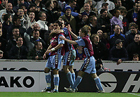 Photo: Lee Earle.<br /> Portsmouth v Aston Villa. The Barclays Premiership. 02/12/2006. Villa's Juan Pablo Angel (L) is congratulated after scoring their second.