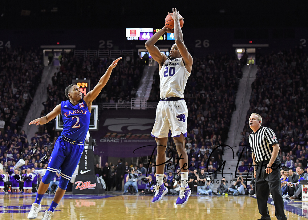 MANHATTAN, KS - February 05: Xavier Sneed #20 of the Kansas State Wildcats puts up a shot against pressure from Charlie Moore #2 of the Kansas Jayhawks during the second half on February 5, 2019 at Bramlage Coliseum in Manhattan, Kansas.  (Photo by Peter G. Aiken/Getty Images) *** Local Caption ***  Xavier Sneed; Charlie Moore