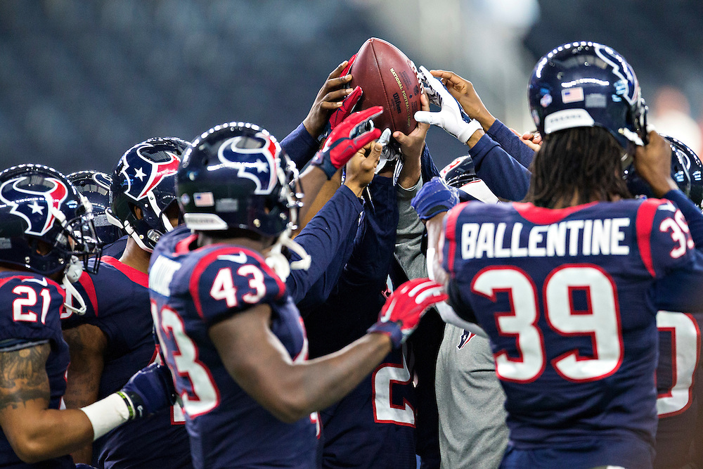 ARLINGTON, TX - SEPTEMBER 3:  Houston Texans gather around the football before a preseason game against the Dallas Cowboys at AT&T Stadium on September 3, 2015 in Arlington, Texas.  The Cowboys defeated the Texans 21-14.  (Photo by Wesley Hitt/Getty Images) *** Local Caption ***