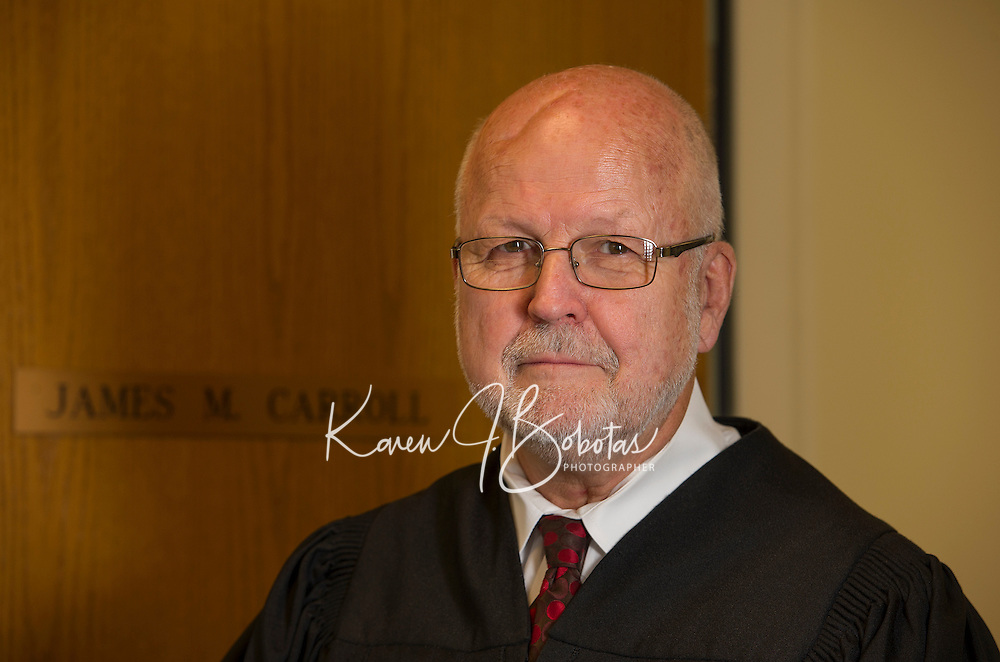 Judge James Carroll in his chambers at Laconia District Court.  (Karen Bobotas/Photographer)