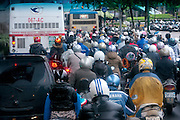 Taipei, Taiwan morning rush hour commute, with thousands of commuters on motor scooters and motorcycles.