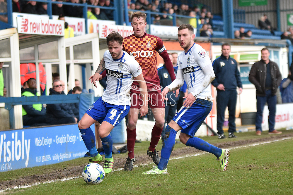 Bury Midfielder, Andrew Tutte and Bury Midfielder, Danny Mayor guard the ball during the Sky Bet League 1 match between Bury and Bradford City at the JD Stadium, Bury, England on 5 March 2016. Photo by Mark Pollitt.