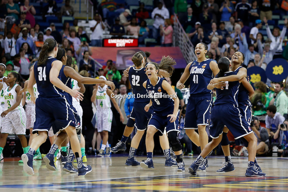 April 7, 2013; New Orleans, LA, USA; Connecticut Huskies celebrates after the semifinals during the 2013 NCAA womens Final Four against the Notre Dame Fighting Irish at the New Orleans Arena. Connecticut defeated Notre Dame 83-65. Mandatory Credit: Derick E. Hingle-USA TODAY Sports