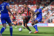 AFC Bournemouth Forward, Callum Wilson (13) holds off Leicester City Defender, Wes Morgan (5) during the Premier League match between Bournemouth and Leicester City at the Vitality Stadium, Bournemouth, England on 15 September 2018.