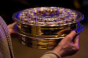 Communion wine and wafers are brought forward during service at Door Creek Church in Cottage Grove, Wisconsin, Sunday, Feb. 4, 2018.
