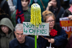 © Licensed to London News Pictures . 29/09/2019. Manchester, UK. A mop signifying British Prime Minister Boris Johnson above a placard reading Not Fit For Office . Thousands attend a march for the People's Assembly . Demonstrations for and against Brexit , austerity measures , the environment and numerous social issues take place across Manchester during the first day of the Conservative Party Conference taking place at the Manchester Central Exhibition Centre . Photo credit: Joel Goodman/LNP