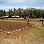 Dressage warm up ings with vendor village in the distance at the Red Hills International Horse Trials in Tallahassee, Florida.