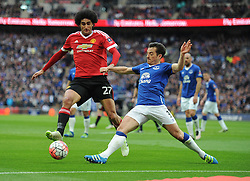 Marouane Fellaini of Manchester United battles for the ball with Leighton Baines of Everton - Mandatory by-line: Alex James/JMP - 23/04/2016 - FOOTBALL - Wembley Stadium - London, England - Everton v Manchester United - The Emirates FA Cup Semi-Final