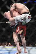 """LONDON, ENGLAND, OCTOBER 2010: Vinicius Queiroz (top) grapples with Rob Broughton during """"UFC 120: Bisping vs. Akiyama"""" inside the O2 Arena in Greenwich, London"""