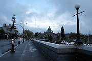 Victoria, British Columbia, Canada at night. Parliament Building in the background, inner harbour on the right