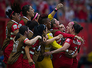 Canada forward Josee Belanger (2nd R) celebrates her goal against Switzerland with teammates during the FIFA Women's World Cup in Vancouver, BC. (2015)